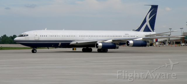 Boeing 707-300 (N88ZL) - A clean looking 707-330, N88ZL, taxis to her parking spot on the tarmac at TAC Air (the FBO at Blue Grass Airport)...