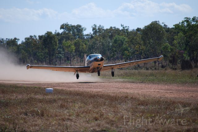 Piper PA-24 Comanche (VH-FLG) - Taking off from Mt Bundy Airstrip, 12th July 2010.