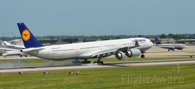 Airbus A340-600 (D-IAHX) - Arriving nonstop from Munich into Charlotte, NC.  Taken from the observation park adjacent to RWY 18C.
