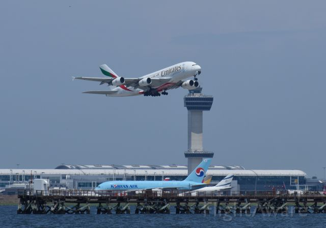Airbus A380-800 (A6-EEK) - Emirates A380 taking off from runway 13R with Kennedy Tower and a Korean A380 in the background. Pic taken with a Nikon D7200.
