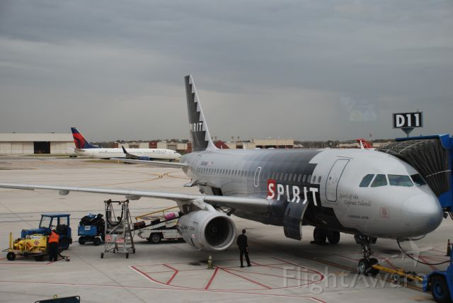 """Airbus A319 (N514NK) - Spirit Airlines """"Spirit of Cayman Islands"""" gets pre-flight inspection at gate D11 at DTW October 13, 2010"""