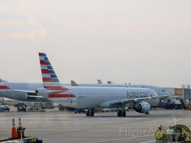 Airbus A321 (N177US) - Alongside An American A330-300