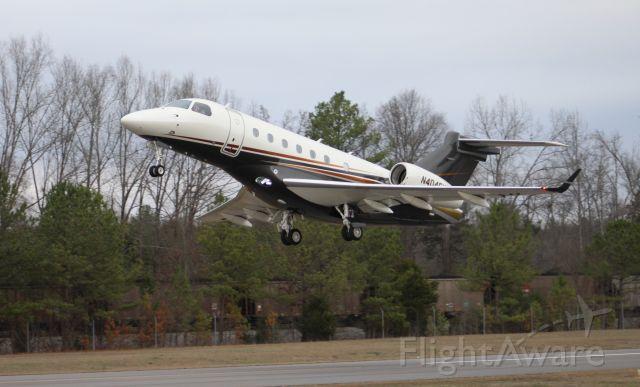 Embraer Legacy 550 (N404FX) - An Embraer 550 Legacy departing Runway 22 at Word Field, Scottsboro Municipal Airport, AL - January 25, 2017.