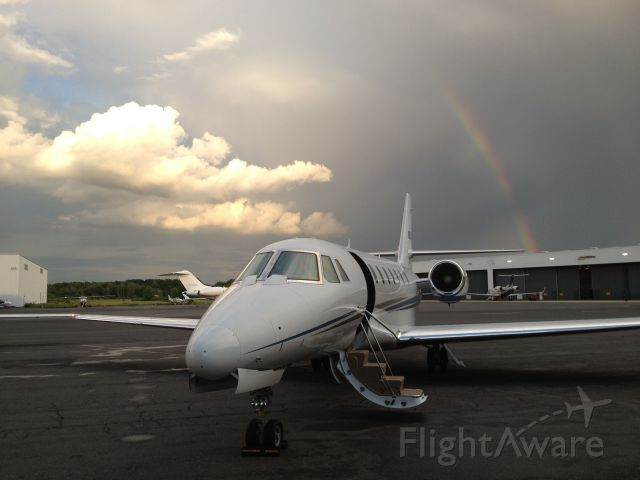 Cessna Citation Sovereign (N626CS) - Citation Sovereign after landing with a thunderstorm and rainbow over NY city.