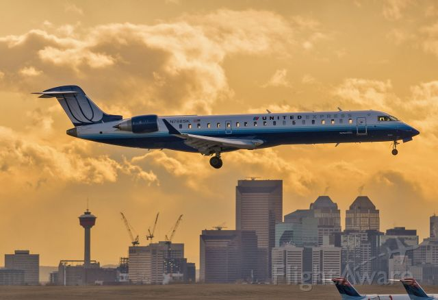 Canadair Regional Jet CRJ-200 (N788SK) - From eleven years ago (2009), just as the sun was going down in Calgary. Downtown looks different now.