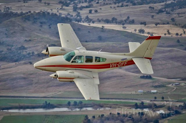 Beechcraft 55 Baron (VH-DFF) - Baron D55 VH-DFF (D-Fifty-Five... clever eh?) over Muswellbrook NSW. Photo by Tanya D'Herville