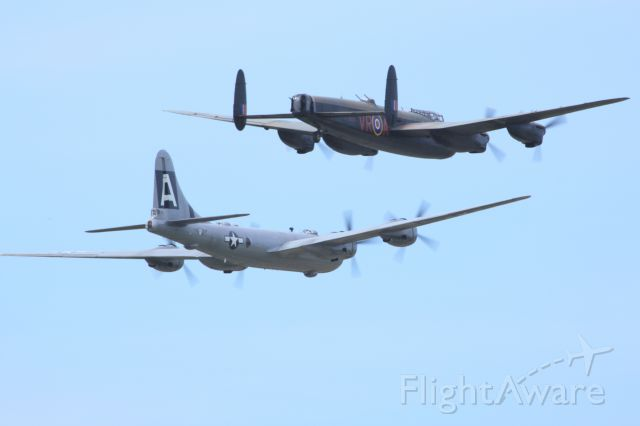 AMU5298 — - With the Canadian Warplane Heritage Avro Lancaster X on her wing, this is a rare sight indeed.