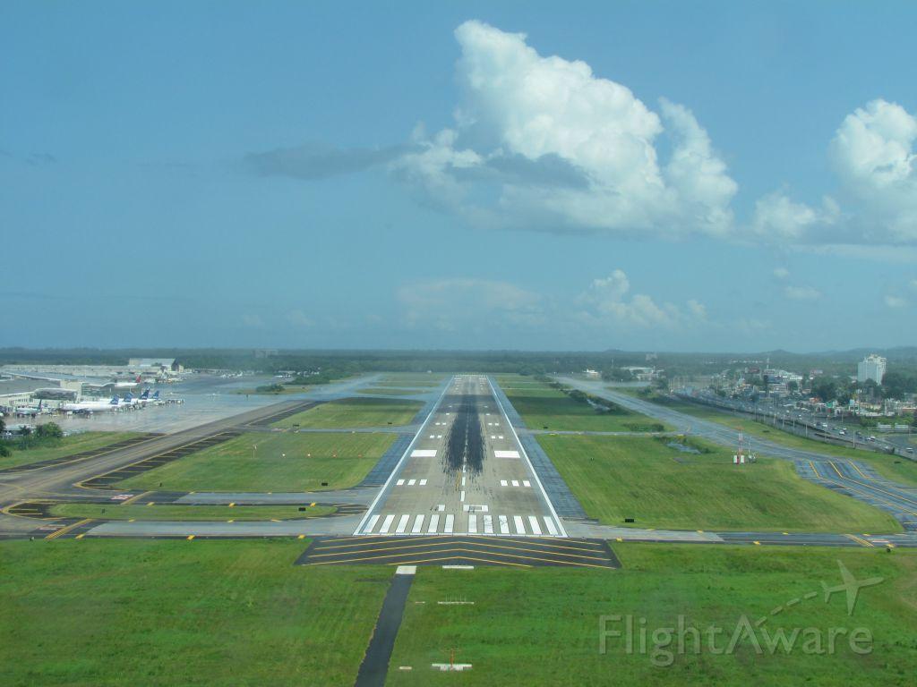 — — - On final to runway 08 at San Juan