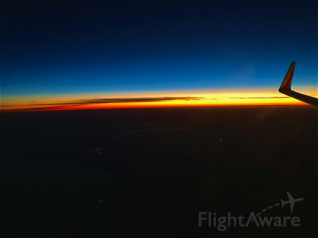 Boeing 737-700 — - Early morning sunrise out of KRSW.
