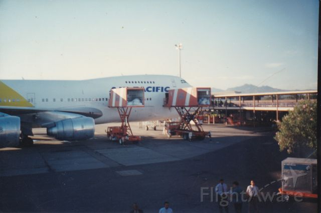 Boeing 747-200 (ZK-NZY) - WOW This was a great photo i had taken back in 1996 when air new zealand leased this Boeing 747-219 to the Fijian carrier here at gate 3 awaiting a final flight to be repainted back into the air new zealand decals nice aircraft