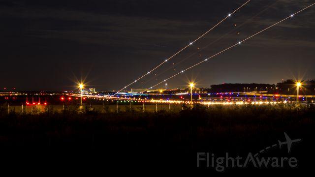 Boeing 737-700 — - Nightshot Runway 07L at Frankfurt Airport
