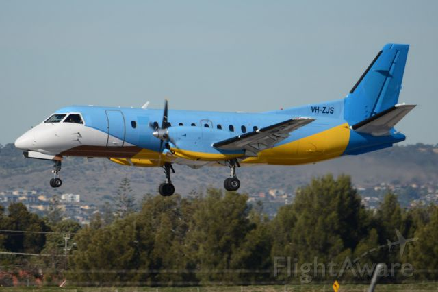 Saab 340 (VH-ZJS) - On short finals for runway 05. Wednesday, 21st May 2014.