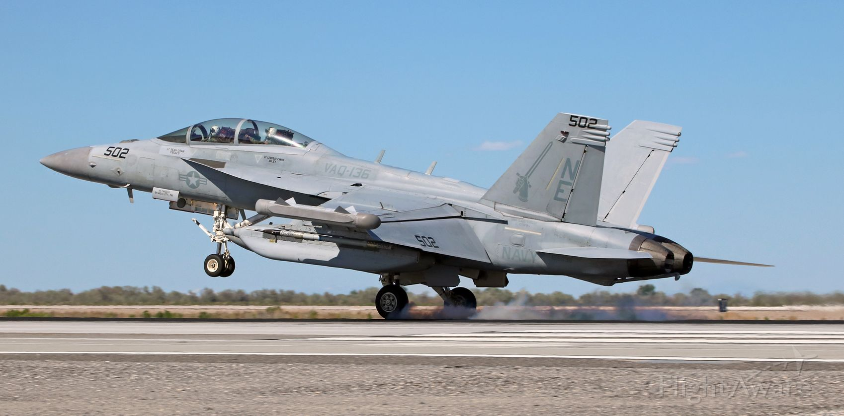 """16-6936 — - A VAQ-136 (Electronic Attack Squadron One Thirty Six) """"Gauntlets"""" E/A-18G Growler, 166936, puts the mains down right by the keys on the runway 31L concrete as it returns to NAS Fallon after completing a combat training sortie.  The """"Gauntlets' Growlers are out of NAS Whidbey Island and are currently assigned to Carrier Air Wing Two, USS Carl Vinson (CVN-70, Puget Sound Naval Shipyard, Bremerton, WA)."""