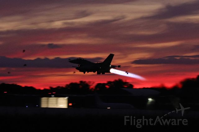 Lockheed F-16 Fighting Falcon (90-0731) - An F-16 Fighting Falcon lighting up what was probably one of the most colorful evening skies over Toledo I've seen.  (11 Aug 1010)