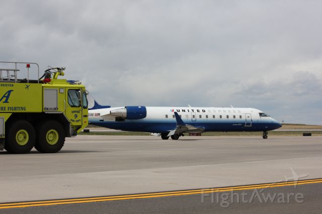 Canadair Regional Jet CRJ-200 (N983SW) - Landed safely on 34L at DIA with a blown out tire on its nose wheel.