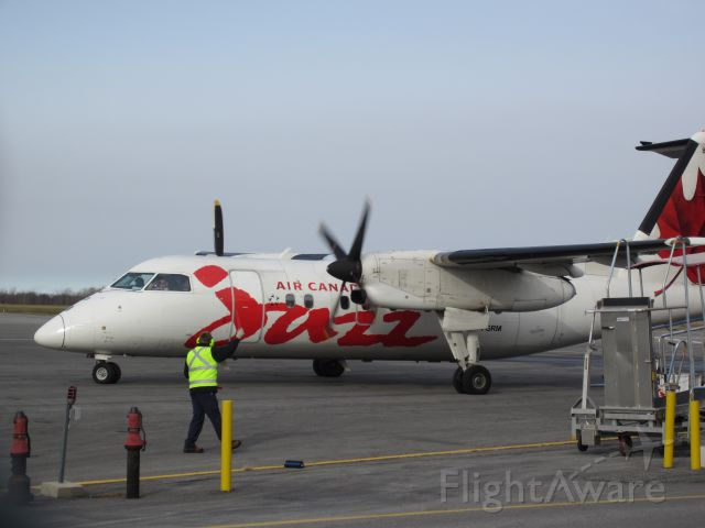 de Havilland Dash 8-100 (C-FGRM) - And were rolling! The Pilot waving to the ground handlers and possibly me!