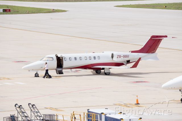 Learjet 45 (ZS-SGU) - Neat example of a LearJet 45 parked on the ramp at FAPE on Tuesday, 4 Sept 2018, prepping for departure on RWY 26. This LJ45 (Serial #365) was built in 2008, and had a paint job to these new colours about a year back.