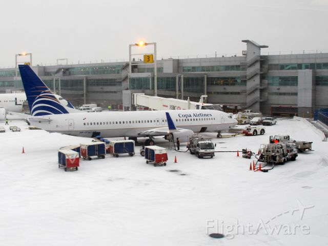 Boeing 737-800 (HP1716CMP) - Winter ops at Kennedy airport.