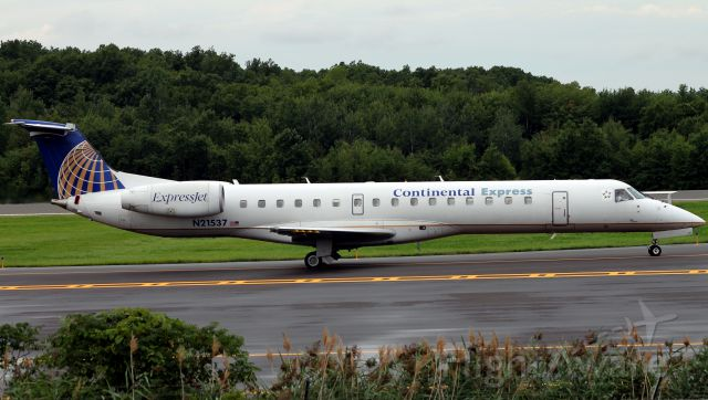Embraer ERJ-145 (N21537) - Taxing by the ILS hold area for 24, one of the few remaining Continental painted aircraft. UPDATE: The aircraft was recently repainted into standard United Express livery.