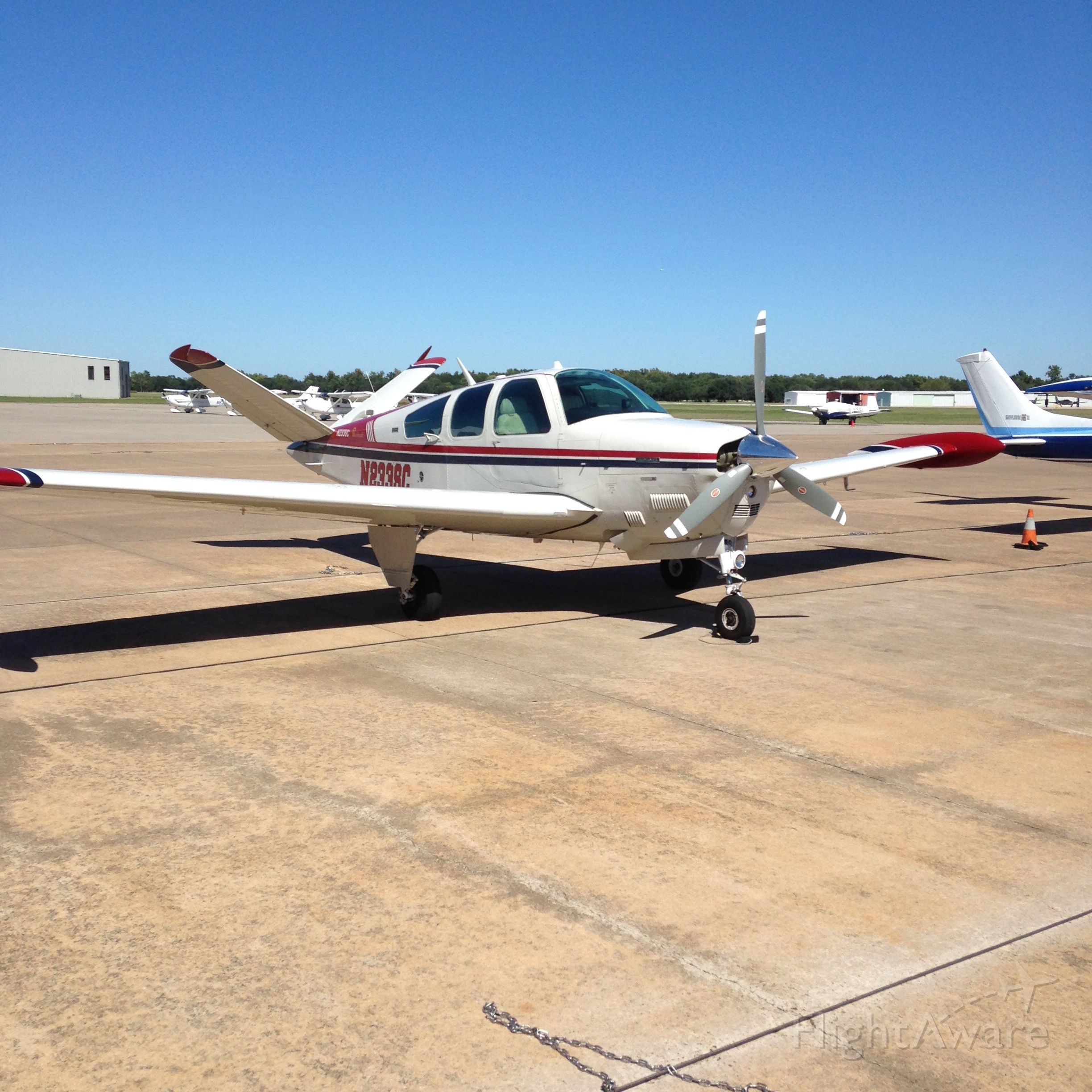 """Beechcraft 35 Bonanza (N233SC) - """"Red Tips"""" having a marathon day flying from GEV-IWS-ABI-IWS almost 9.5 hours in one day.  Here she is at KIWS mid-trip."""