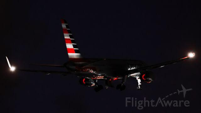 Boeing 757-200 (N941UW) - American Airlines N941UW B757-200 seen blowing her 2 X ROLLS-ROYC RB.211 SERIES at 22000 Horsepower/Thrust while departing St Maarten after dark.