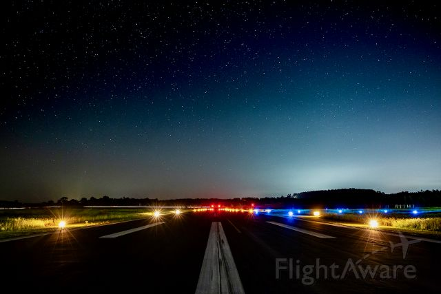 — — - A very early morning shot from the centerline of 18/36, KOCH's north/south runway. Thorough precautions were taken to monitor for incoming aircraft. We simply don't have many flying in at 2 AM.