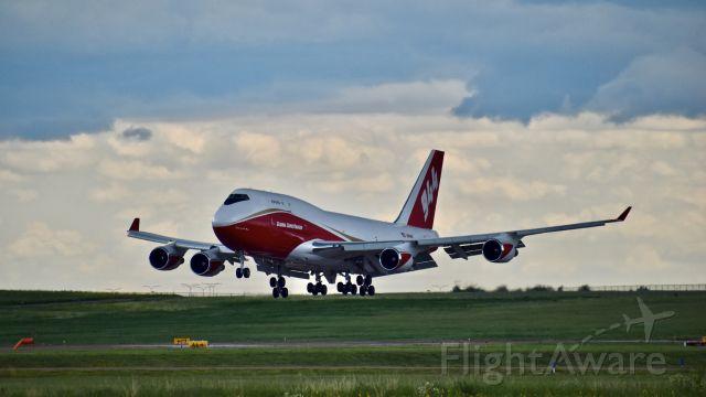 Boeing 747-400 (N744ST) - Global SuperTanker (N744ST) Boeing 747-446 (BCF) landing on RWY 35L at Colorado Springs Airport after a return flight from Marana, Arizona