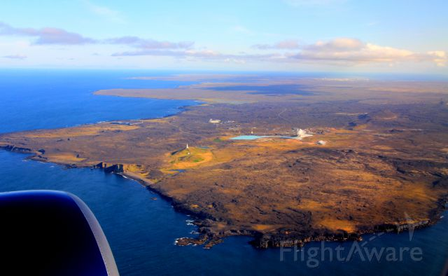 — — - Window seat on approach to Keflavik Airport in Iceland on a summer day