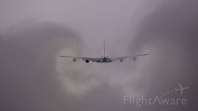 Airbus A380-800 (F-HPJC) - Air France Airbus A380-800 on the go-around after missed approach and flying through low cloud disturbing the cloud and generating vortices.