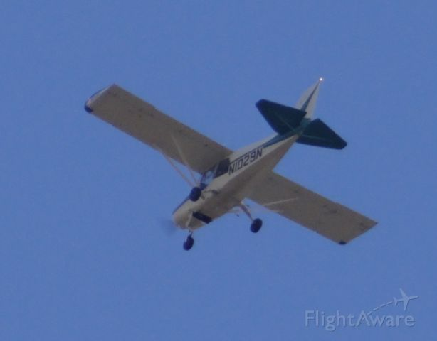 N1029N — - I was walking in my neighborhood with my camera and saw it flying over. I got a horrible picture but decided to upload it anyways.