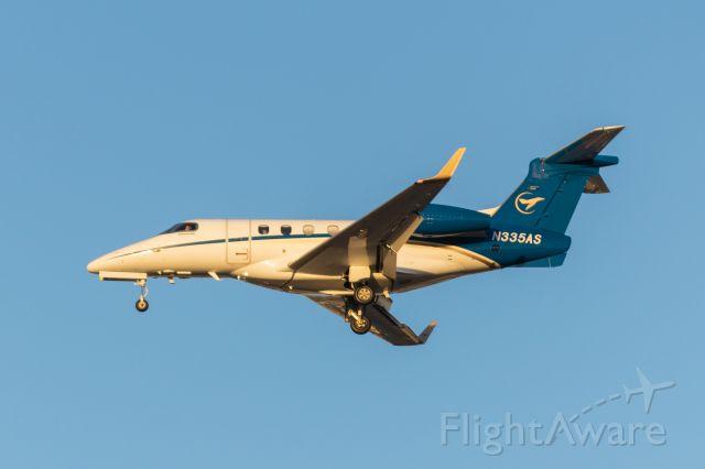 Embraer Phenom 300 (N335AS) - Arriving 31L
