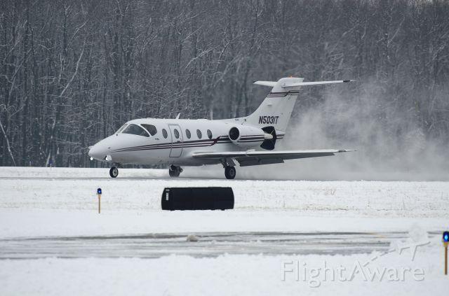 Beechcraft Beechjet (N5031T) - Landing Runway 8 just after runway was plowed
