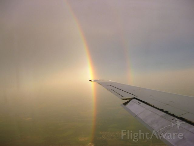 McDonnell Douglas MD-80 (MDG80) - A double rainbow follows MD-80 on it
