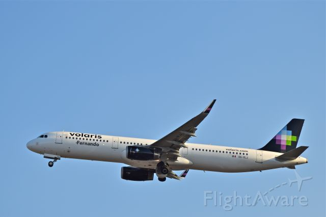 "Airbus A321 (XA-VLJ) - Volaris A321, named ""Fernando"" depart from Mexico City airport 05L runway."