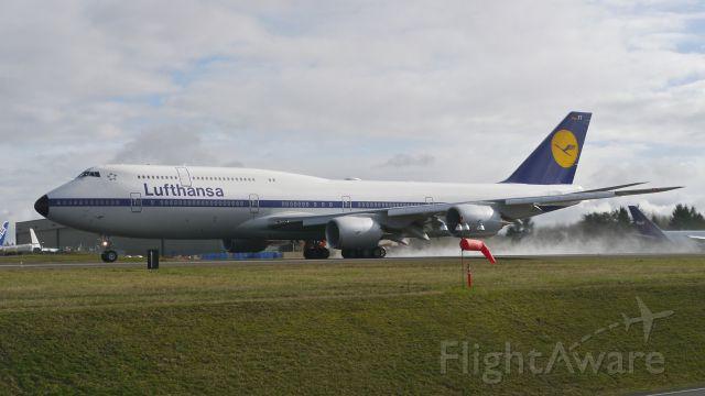 BOEING 747-8 (D-ABYT) - BOE39 begins its takeoff roll on Rwy 34L for its B1 flight on 2/14/15. (ln 1513 / cn 37844).