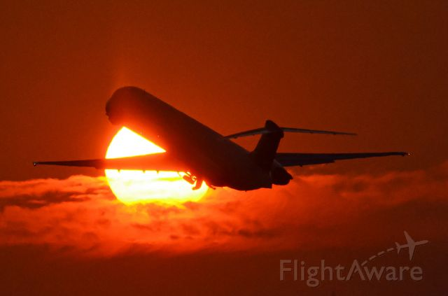 McDonnell Douglas MD-88 (N971DL) - Taking off into the sunset