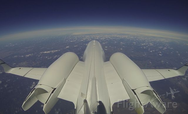 Learjet 60 — - From Gopro video. Not so high, FL370 near SBCT. Tail# PP-BED. See video in Youtube, find to PP-BED.
