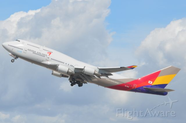— — - Asiana Airlines 747 takes off at LAX