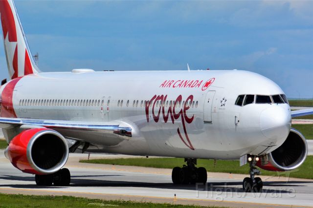BOEING 767-300 (C-FXCA) - Air Canada Rouge Boeing 767-375(ER) arriving at YYC on July 1.