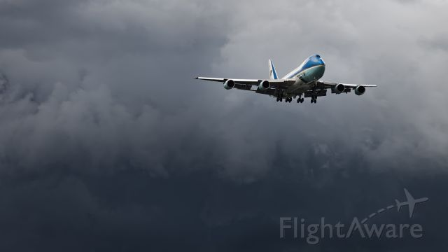 Boeing 747-200 (N29000) - Threading the needle. AF-1 threading the needle  with large Thunderstorms near the short final to 19L