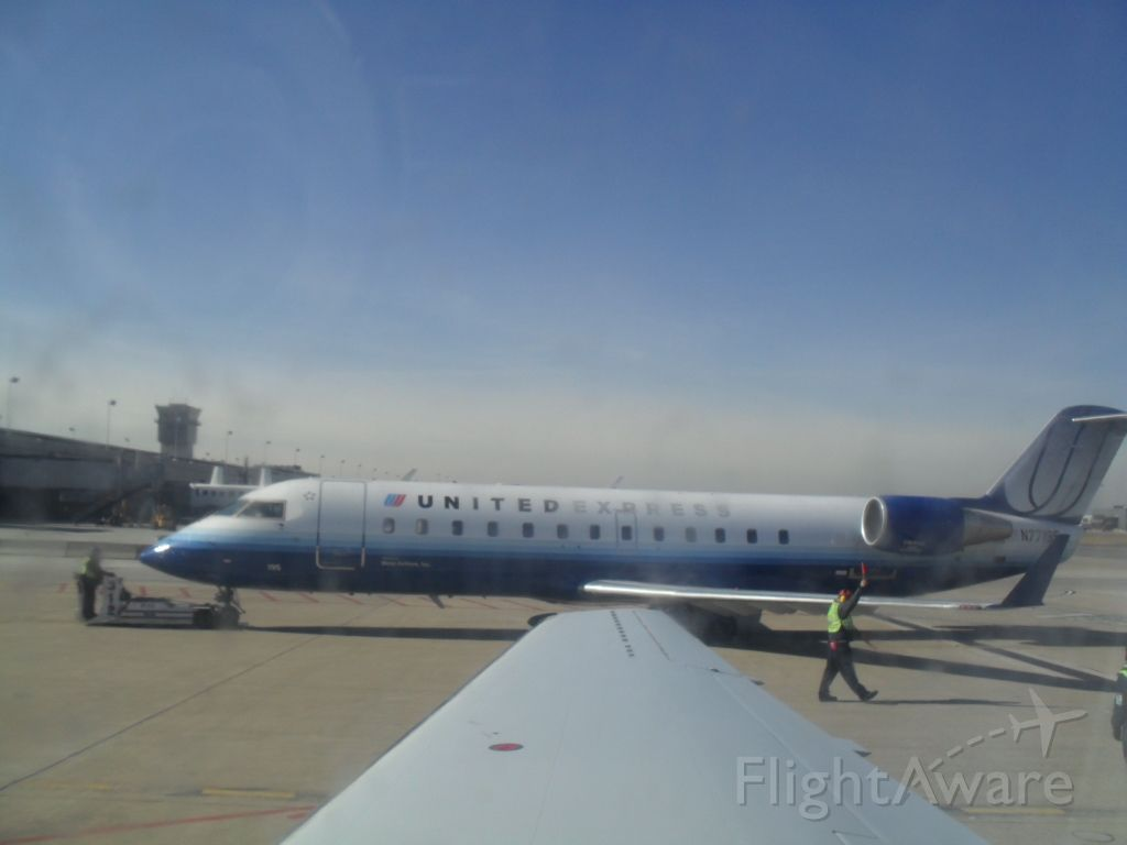 Embraer ERJ-145 (N77195) - UNITED EXPRESS AT IAD OPERATED BY MESA AIRLINES. 1-25-10