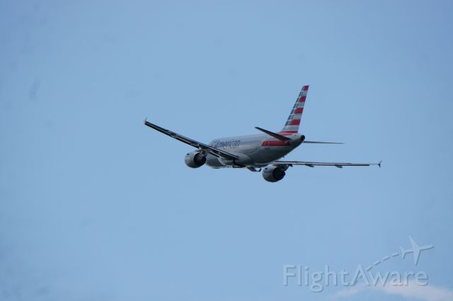 Airbus A319 (N702UW) - One of the Newly painted A319s operated by US Airways departs runway 1 to Charlotte.