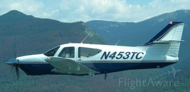 Rockwell Commander 114 (N453TC) - formation flight in Alaska