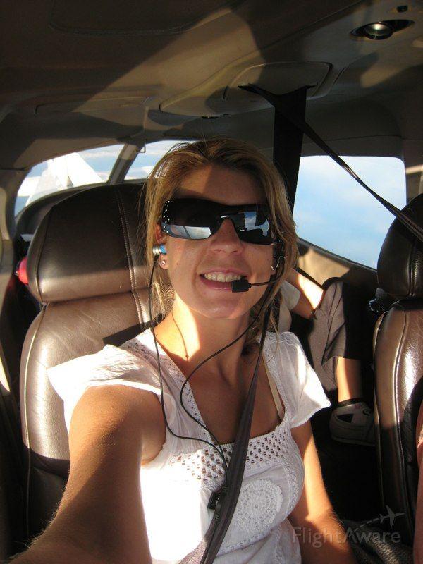 Cessna Skyhawk — - Self portrait wearing her new LightSpeed Mach 1 headset.  Somewhere over Montana.