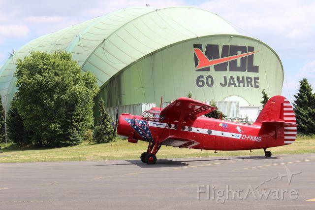 Antonov An-2 (D-FKMB) - In the background is the zeppelin hangar at Mülheim-Essen airport.