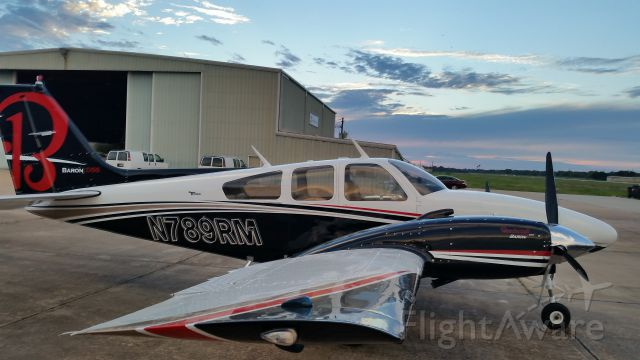 Beechcraft 55 Baron (N789RM) - New paint by Murmer Aircraft Painting at Houston Southwest Airport, Arcola,TX