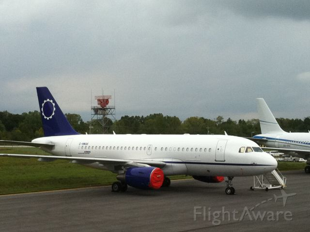 Airbus A319 (G-NMAK) - TwinJet A319 sits on the Wilson Air Center CHA ramp on Sept 22-24, 2011
