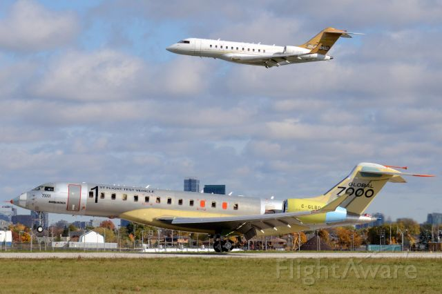 Bombardier Global Express (C-GLBO) - Photographed by Frederick K. Larkin as it landed after its first flight.