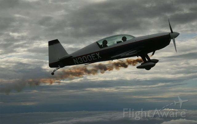 EXTRA EA-300 (N300EX) - Aerial view of Extra 300 with smoke trail. High over Homestead, FL.