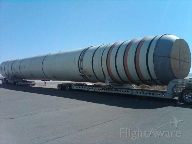 — — - Solid Rocket Boosters from the STS (Space Shuttle) being off-loaded at NASA Dryden Flight Reseach Center. THey will eventually be on dispaly at the California Science Center museum in Los Angeles as part of the Endeavour display